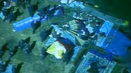 Police at the camp at Oakland's Frank Ogawa Plaza
