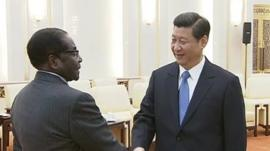 Robert Mugabe and Xi Jinping