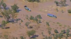Lorries in a flooded road