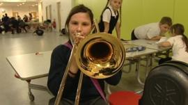 Girl playing the trombone