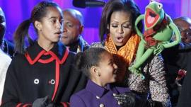 Michelle Obama with daughters and Kermit the frog