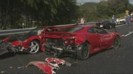 Two of the crashed supercars