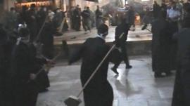 Brooms being thrown in the fight