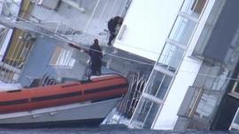 Rescuers board the Costa Concordia