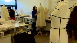 Fashion students work with larger mannequins