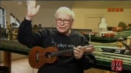 Warren Buffett with a guitar