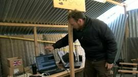 BBC Scotland reporter Cameron Buttle shows broadcast equipment in an army base in Afghanistan