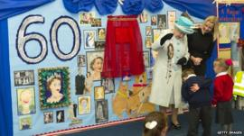 The Queen is given gifts by the pupils