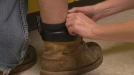 Tag fitted around man's ankle