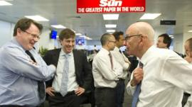 Rupert Murdoch pictured with staff members of The Sun