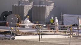 Fukushima workers in protective clothing