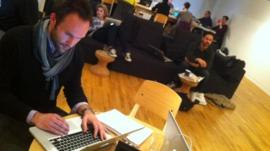 A man working on his laptop at General Assembly