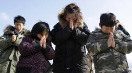 Family say prayers for tsunami victims
