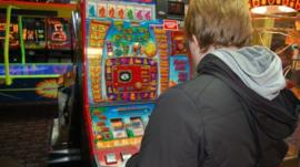 Man at fruit machine
