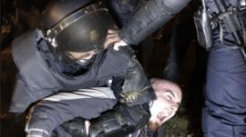 Police officer holds down striker in Spain