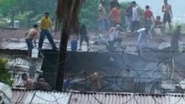 A fire being put out at the San Pedro Sula prison in Honduras.