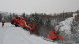 Truck falls from road