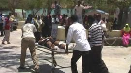 Injured person on a stretcher in Mogadishu