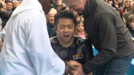 A person being baptised by the Archbishop of York