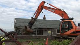 Demolition begins on a Happisburgh bungalow.