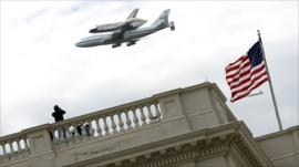 Shuttle Discovery flies over Washington, DC