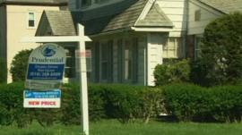 House and 'for sale' sign