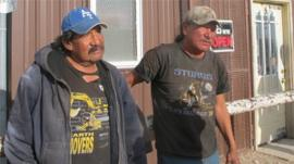 Two men drinking on the streets of White Clay, Nebraska 23 April 2012