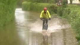 Cyclist in floodwaters