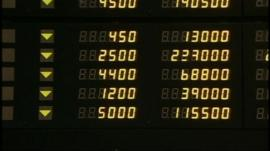 A markets board at the Hong Kong Stock Exchange