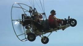 A paratrike in flight