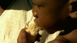 Malawi baby eating bread