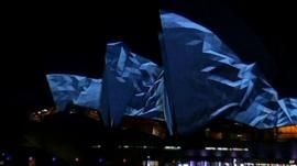 Light show projected onto Sydney Opera House