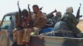 Malian men sat on a truck