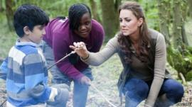 Duchess of Cambridge speaks to young people during a visit to the