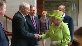 Sinn Fein first minister Martin McGuinness shakes hands with The Queen