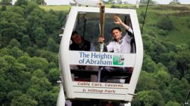 Dominick Cunningham carrying the Olympic flame on the Heights of Abraham sky-ride