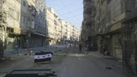 A Syrian opposition flag is seen at al-Tadamun area in Damascus