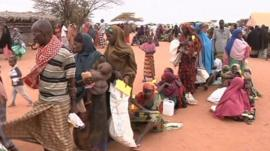 Families queue for food in Somalia