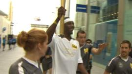 Phillips Idowu with Olympic torch