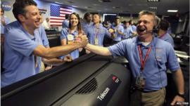 Celebration in the control room