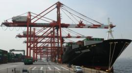 A cargo ship lands alongside a quay in Tokyo