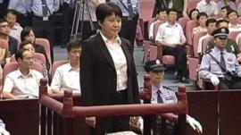 Gu Kailai attends a trial in the court room at Hefei Intermediate People's Court in China, 9 Aug 2012