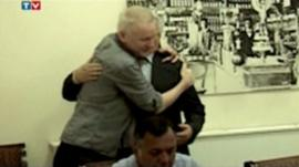 Julian Assange receiving a hug from his lawyer in the Ecuadorian embassy