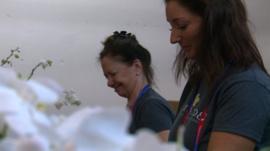 Women work in a flower shop