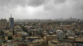 Monsoon clouds loom over Mumbai's skyline. Are dark clouds looming over the economy?