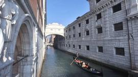 A gondola passes Venice's Bridge of Sighs