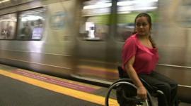 Wheelchair user Viviane Macedo waiting for a train in Rio