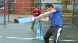 members of the team playing cricket
