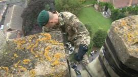 Marine starting his abseil down the church tower