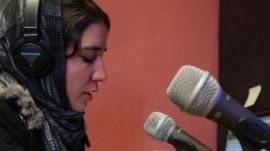 An Afghan women in a radio station.
